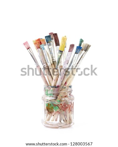 Old paint brushes isolated on white - stock photo