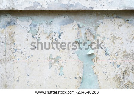 Old paint on a wall Damaged effect by flood / Old paint on a wall   - stock photo
