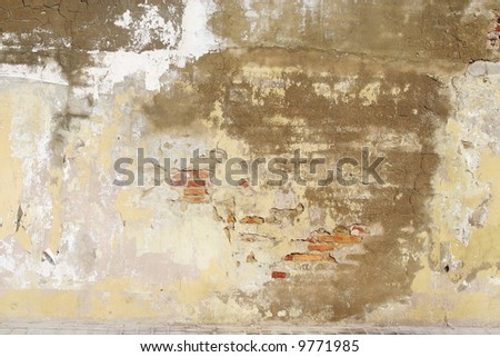 old  painted brick rusty wall can be used as background - stock photo