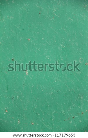Old painted green grunge rusty metal surface. Background. - stock photo