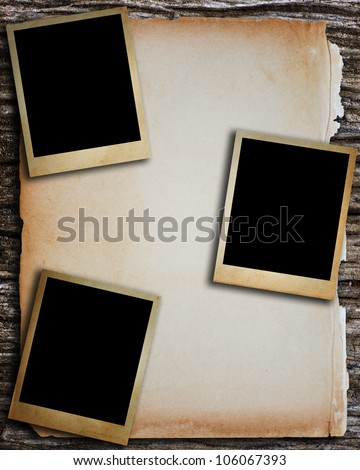 Old paper and old photo frame put on the wood table. - stock photo
