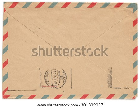 "Old paper envelope with meter stamp on rear side and one side cut off. Russian inscription: ""Manufactured""  - stock photo"