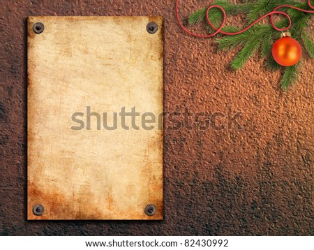 old paper is attached with nails on painted walls and Christmas tree - stock photo