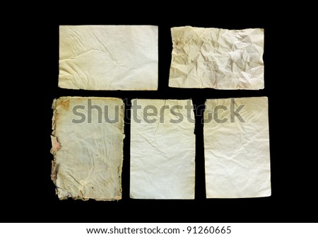 Old paper isolated on black - stock photo