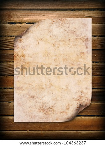 Old paper on brown wood background - stock photo