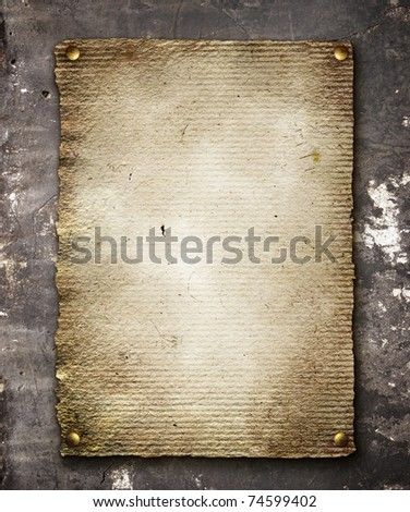Old paper on concrete wall - stock photo