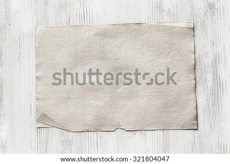 old paper on white wooden background - stock photo