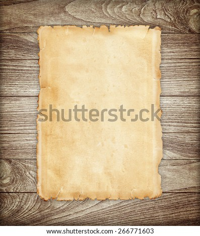 Old paper on wood background. - stock photo
