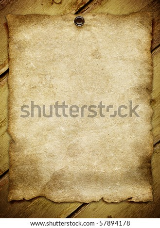 old paper on wood background with space for your text or image - stock photo