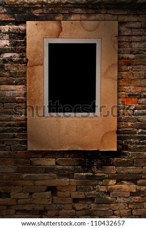 old paper photo frame on old brick wall texture, grunge industrial interior Uneven diffuse lighting version (Save Paths For design work) - stock photo