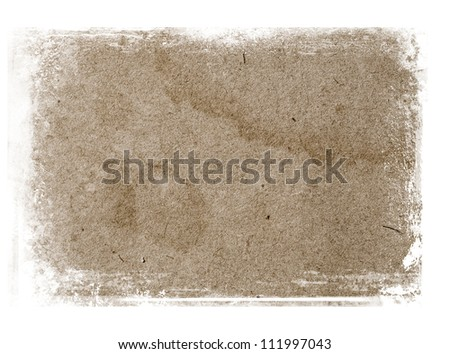 Old paper texture with grungy messy border - stock photo