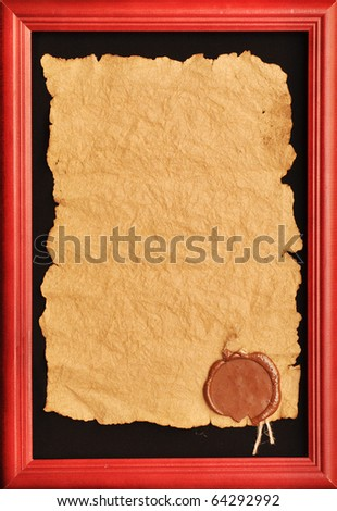 old paper with a wax seal in wooden frame - stock photo