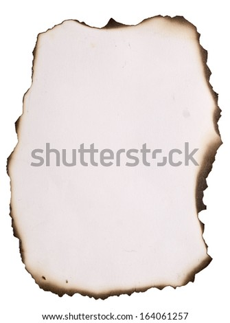 old paper with burnt edges over white - stock photo