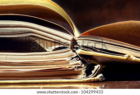 Old papers and books on a dark background - stock photo