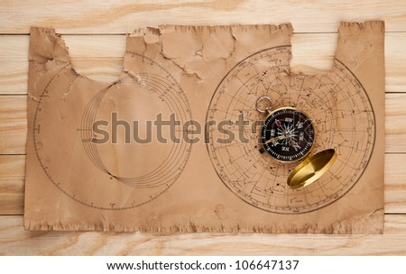 old papers and compass on wooden stome - stock photo