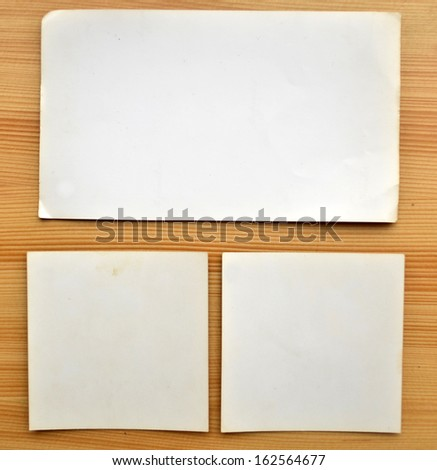 Old papers isolated on wooden background - stock photo