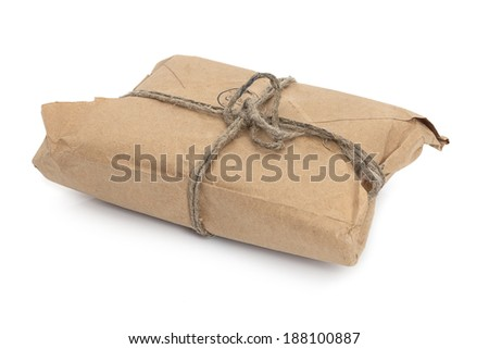 Old parcel  tied with a string, isolated on white background  - stock photo