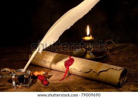 Old parchment or diploma scroll with wax seal and quill pen - stock photo