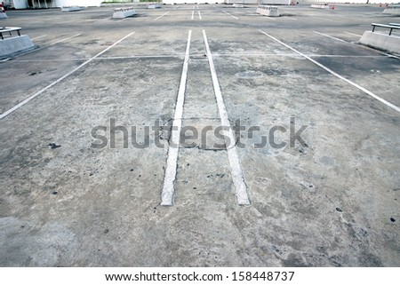 Old parking lot - stock photo