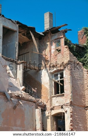 old partially collapsed house - stock photo