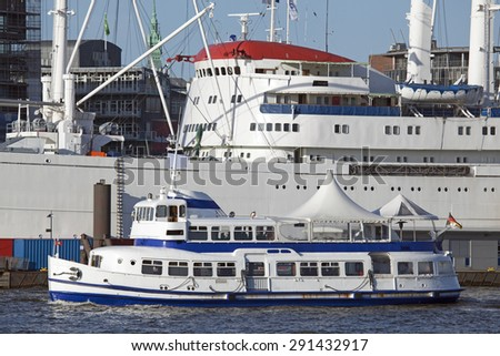 Old passenger ship and traditional freight ship in Hamburg, Germany - stock photo