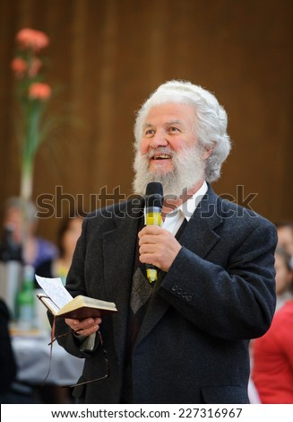 Old pastor preaching at the wedding reception - stock photo