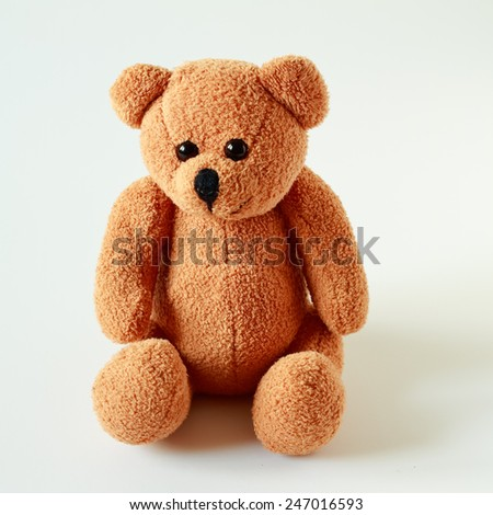 Old patched brown teddy bear isolated on white - stock photo