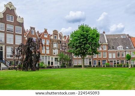 Old patio of Begijnhof in Amsterdam, The Netherlands - stock photo