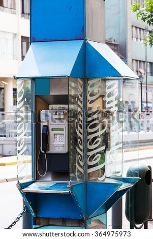 old payphone on a city street - stock photo