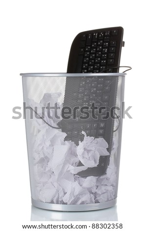 Old PC keyboard and paper in metal trash bin isolated on white - stock photo