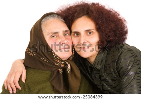 Old peasant woman with her daughter embracing, isolated on white background - stock photo