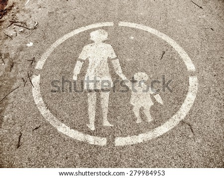 old pedestrian sign painted on asphalt - stock photo