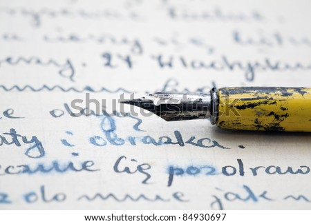 Old pen and letter - stock photo