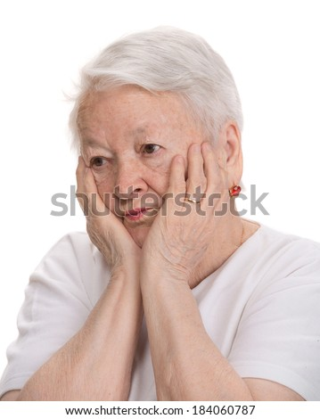 Old pensive woman on a white background - stock photo