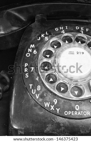 Old Phone - Old Dusty Rotary Dial Phone - stock photo