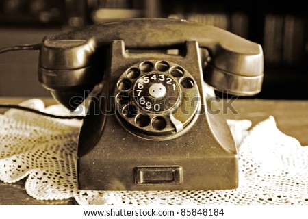 old phone on a table - stock photo