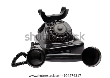 Old phone with taken off receiver - stock photo