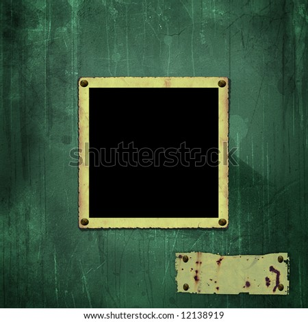 old photo frame on the green wall - stock photo