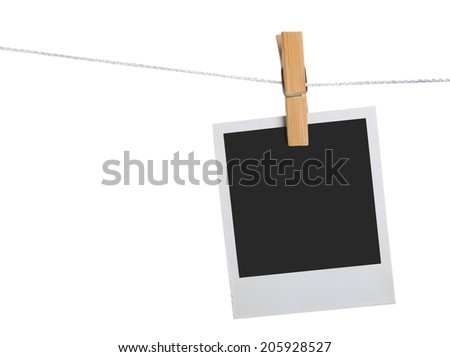 old photo frame palaroid attach to rope clothes peg over white background - stock photo