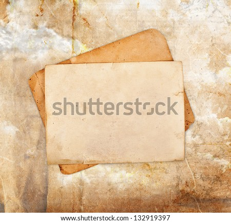 Old photo frames on vintage background - stock photo