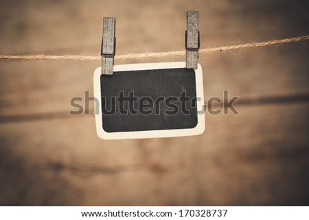 Old photo postcard and clothes peg on wood  - stock photo