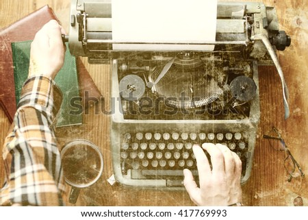old photo typewriter retro hand wooden table - stock photo