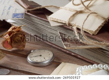 old photos and letters on the wooden table - stock photo