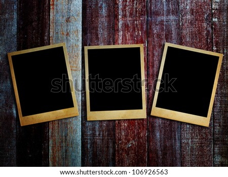 Old photos frame put on the old wood. - stock photo
