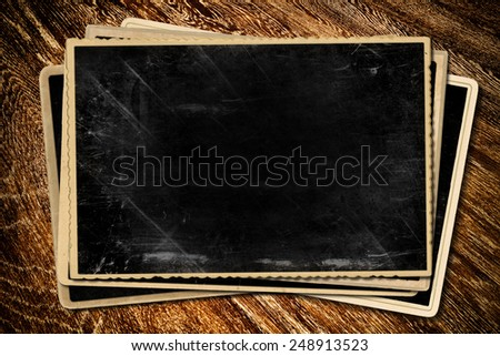 Old photos on wooden table. - stock photo