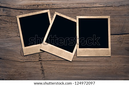 old photos on wooden wall - stock photo