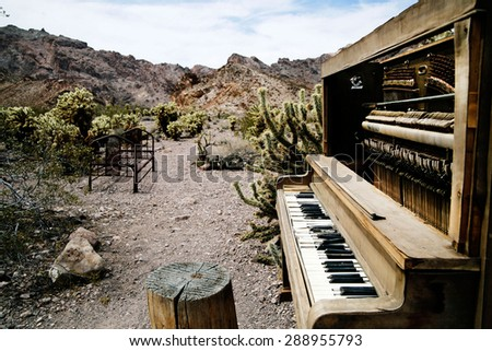 old piano in ghost town Nelson, Nevada - stock photo