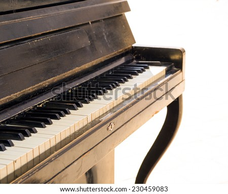 Old piano isolated on white - stock photo