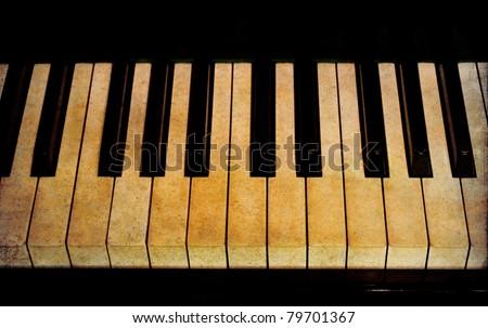Old piano keys - stock photo