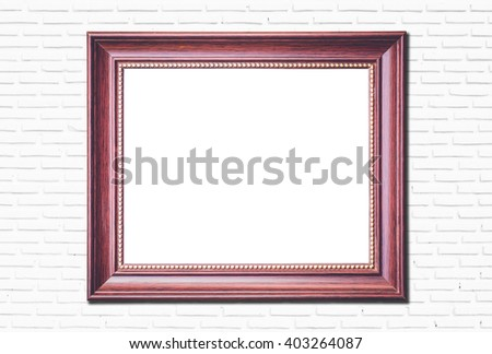 old picture frame on white brick wall background - stock photo